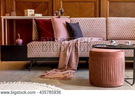 Stylish Interior Of Living Room With Design Pink Velvet Sofa, Elegant Pouf, Coffee Table, Plant, Pil