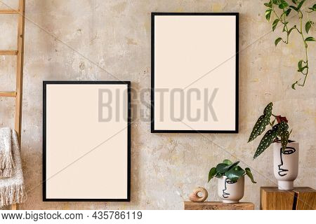 Interior Design Of Living Room With Two Black Poster Mock Up Frames And Potted Plants. Grunge Wabi S
