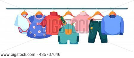 Kids Clothes On Hangers. Wardrobe Of Casual Clothes For Children Jackets Pants Fabric Colorful Dress