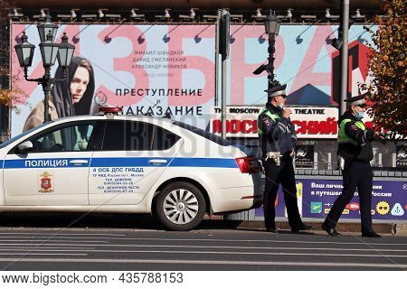 Moscow, Russia - October 2021: Two Traffic Police Officers In Masks Standing On The Road Near Their