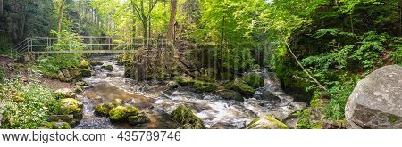 Bend Of The Wild River With An Iron Footbridge, In The Woods, With Rapids And Rocks, Doubrava River