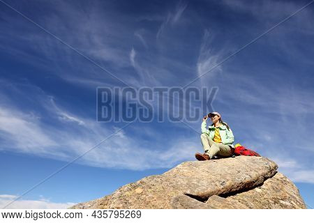 Tourist With Backpack On Cliff In Mountains, Low Angle View
