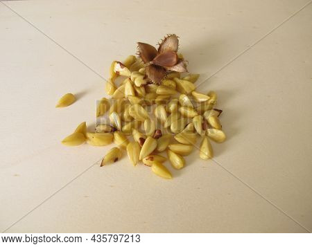 Shelled Beechnuts Without Hull On A Wooden Board