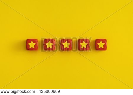 Golden Five 5 Stars, Best Excellent Services Rating On A Red Cubes