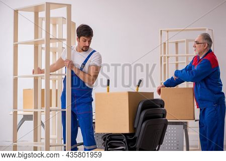 Two male professional movers doing home relocation