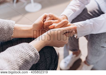 Close-up Female Hands Holding Each Other. Care, Trust, Psychotherapy, Support, Mutual Assistance Con