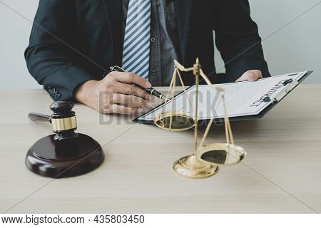 Professional Man Lawyers Work At A Law Office There Are Scales, Scales Of Justice, Judges Gavel, And