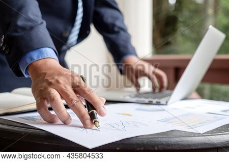 Work From Home, The Hand Of The Businessman Who Works In Finance At Home And Calculates Financial Gr