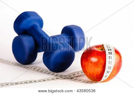 Blue Dumbbells And Red Apple With Measure Tape