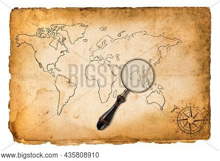 Old Map With Wind Rose And Magnifying Glass Isolated On White
