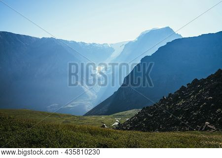 Scenic View To Mountain Valley With Stony Mountainside On Background Of Big Snowy Mountain Top In Su
