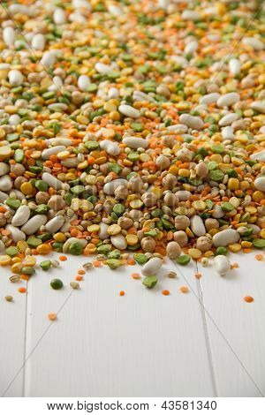 Mixed Beans And Pulses On White Wood