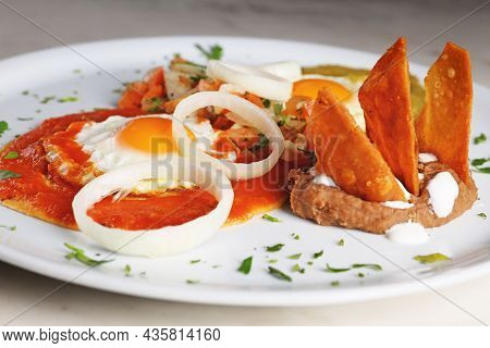 Huevos Divorciados, Fried Eggs On Corn Tortillas With Salsa Verde And Roja , Mexican Breakfast