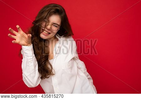 Portrait Of Young Emotional Positive Sexy Beautiful Brunette Woman With Sincere Emotions Wearing Cas