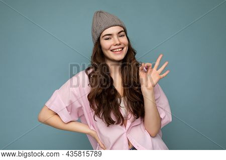 Portrait Of Young Positive Happy Winsome Charming Curly Brunette Woman With Sincere Emotions Wearing