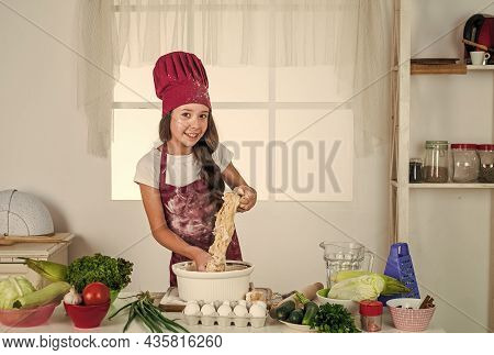 Childhood Development. Small Girl Baking In Kitchen. Kid Chef Cooking Making Dough. Child Prepare He