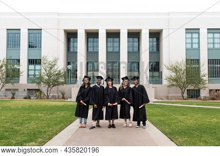 University students in graduation gowns