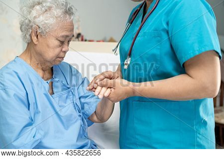 Touching Asian Senior Or Elderly Old Lady Woman Patient With Love, Care, Helping, Encourage And Empa