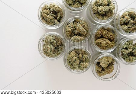 Cannabis Drying And Curing. Marijuana Buds In Glass Jars. Eco Container. Hemp Growing Concept.