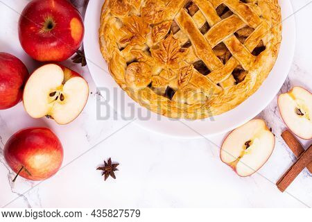 Apple Pie And Spices Cinnamon And Star Anise And Red Apples. Top View.