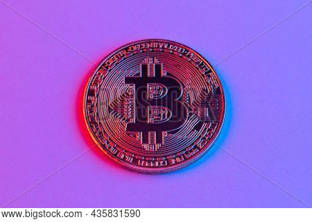 Bitcoin Coin In Red And Blue Neon Light