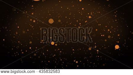 Image of warm glowing orange spots floating on brown background. light, colour and movement concept digitally generated image.