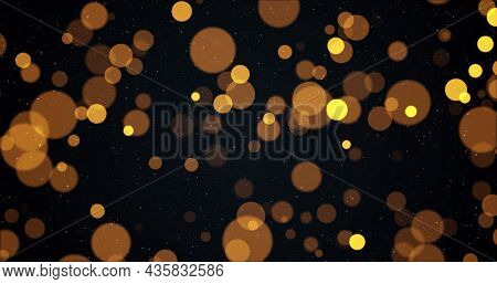 Image of warm glowing yellow and orange spots on black background. light, colour and movement concept digitally generated image.