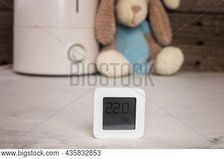 Air Humidifier And Electronic Hygrometer. Knitted Toy Dog. Humidity In The Children's Room. Close Up