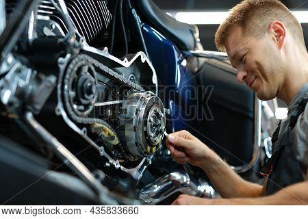 Master Repairing Motorcycle In Workshop Using Wrench