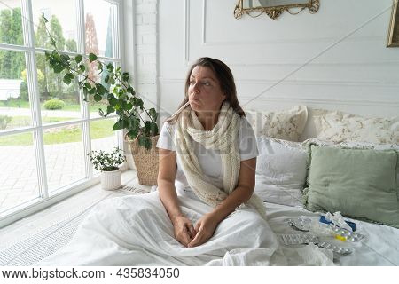 Sick Woman Sitting In The Bed With Thermometr In Her Mouse, Cold, Flue And Coronavirus Disease Conce
