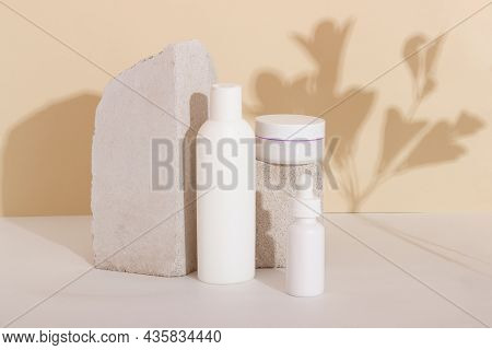 Face And Body Skin Care Products In A Glass Bottle With A Pipette On The Podium. Cosmetics For Women