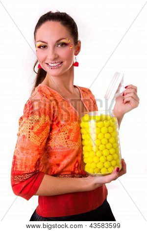 smiling girl with jar of yellow sweets