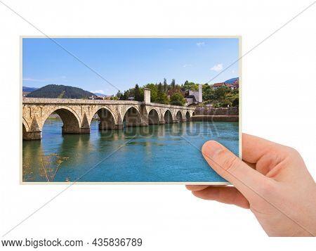 Hand and Old Bridge in Visegrad - Bosnia and Herzegovina (my photo) isolated on white background