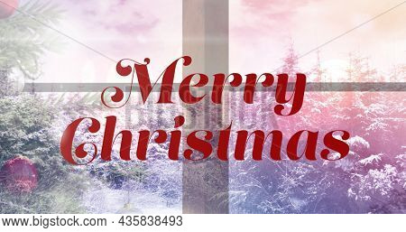 Image of merry christmas text over winter scenery. christmas, winter, tradition and celebration concept digitally generated image.