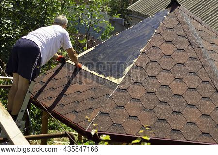 The Roofer Lays The Preparatory Material For Fixing The Slate On The Roof