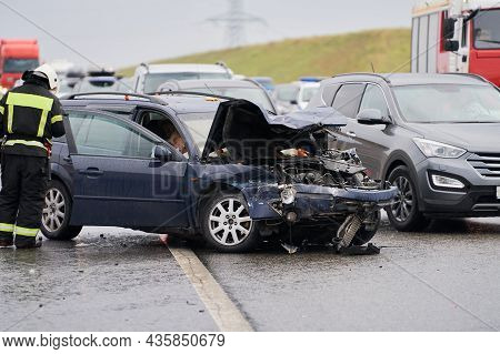 Consequences Of An Accident On The Road. A Car With A Broken Hood. There Are Vegetables On The Motor