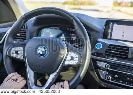 Cloes Up View Of Female Hands On Steering Wheel Of Bmwix3. Sweden. Uppsala. 10.11.2021.