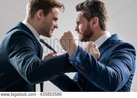 Fist Punching Selective Focus. Aggressive Negotiations. Businessmen Having Conflict.