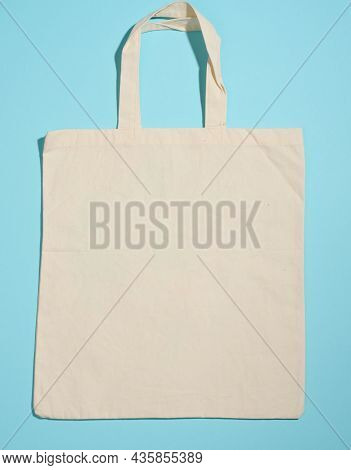 Empty Linen Eco Friendly Beige Canvas Tote Bag For Branding On Blue Background. Clear Reusable Bag F