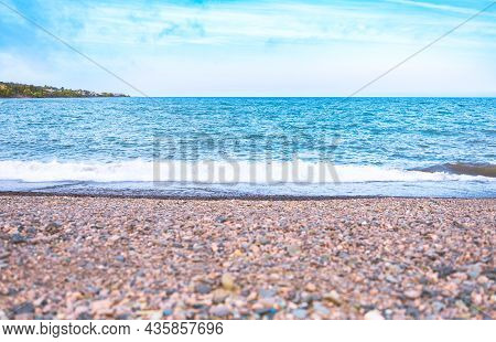 Sea Horizon, Tropical Lake And Clouds Blue Sky With Wave Swash The Rock Beach, Selective Focus. Seas