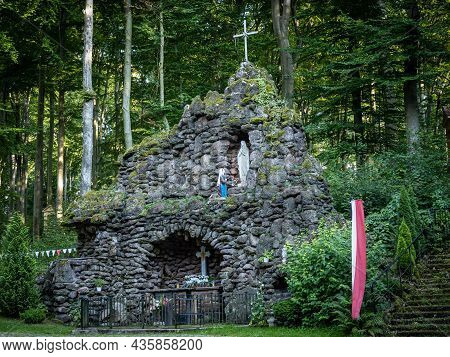Trzebnica, Poland - August 29, 2021: A Stone Cave With Altar Of Saint Mary, Surrounded With Forest,