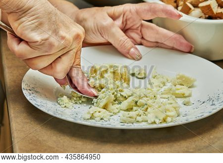 With A Fork, The Chef Kneads Mashed Potatoes On Plate