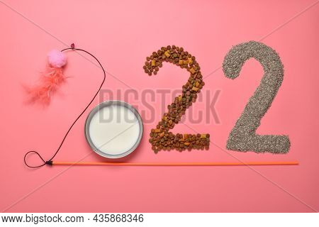 The Numbers 2022 Are Laid Out With Objects For Animals On A Pink Background. Themed Christmas Card F