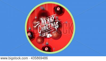 Image of merry christmas text over christmas baubles. christmas, winter, tradition and celebration concept digitally generated image.