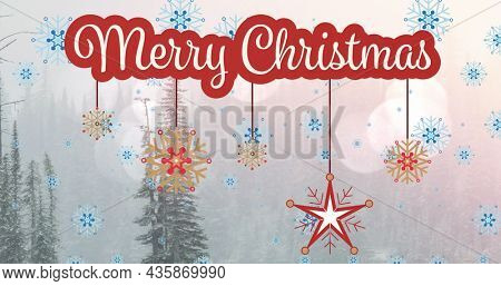 Image of merry christmas text over winter scenery with fir trees. christmas, winter, tradition and celebration concept digitally generated image.