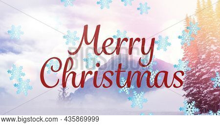 Image of merry christmas text over winter scenery and snow falling. christmas, winter, tradition and celebration concept digitally generated image.