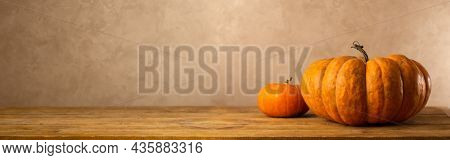 Still life of different type pumpkin on wooden table. Concept autumn harvest food.Banner