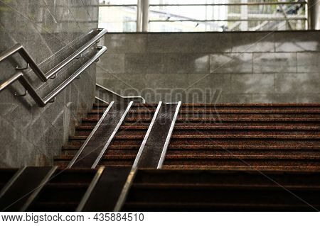 Pedestrian Crossing Staircase. Two Handrails For Wheelchairs. Metal Railings For Bicycles, Wheelchai