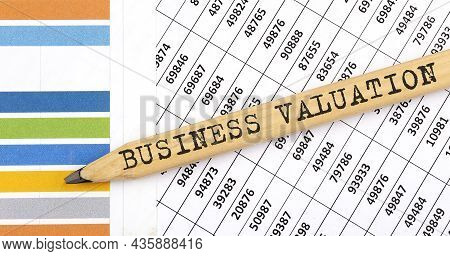Business Concept Business Valuation Text On The Pencil On The Chart Background