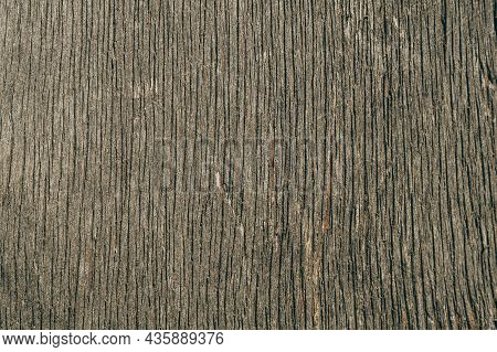 Close-up Of An Old Dirty Sheet Of Plywood Damaged By Time And Weather. The Texture Of Old Plywood.
